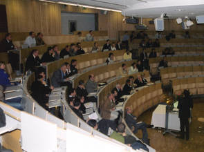 left picture: summary lectures in the auditorium, right picture: postersession with the Advisory Board